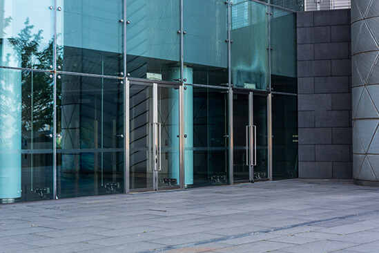 Outside office building with glass doors and windows